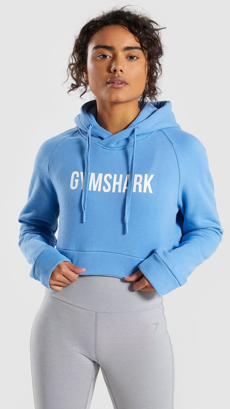 The Cropped Crest Hoodie, Malibu Blue. We're dreaming of sunny summer days, ready to rock this look...