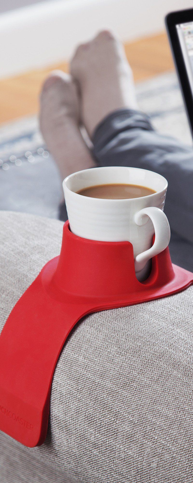 CouchCoaster's couch drink holder, discovered by The Grommet, keeps your drinks close by. Drape…