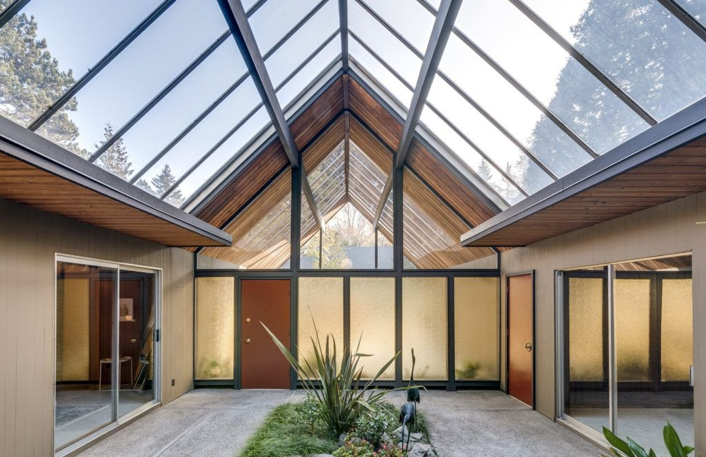 Post and beam with huge atrium lists for $700k near ...