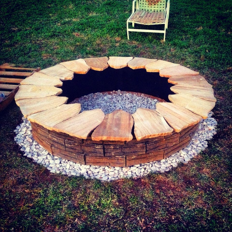 Diy Low Cost Fire Pit The Platform Is White Marble Rocks This Helps To Retain Heat And Radiate Out The Base Is Ma Backyard Fire Patio Tiles Building A Patio