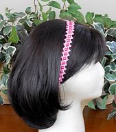 Ravelry: Pretty in Pink Headband pattern - One of eleven projects included in the Joyous Jewelry Collection pattern set - $6.00.