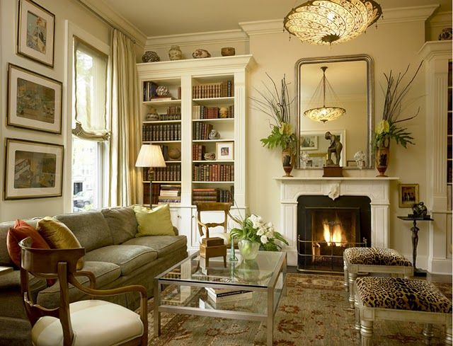 The bookcase, the fireplace, the moldings as well as the fine furnishings all contribute to make a lovely room.