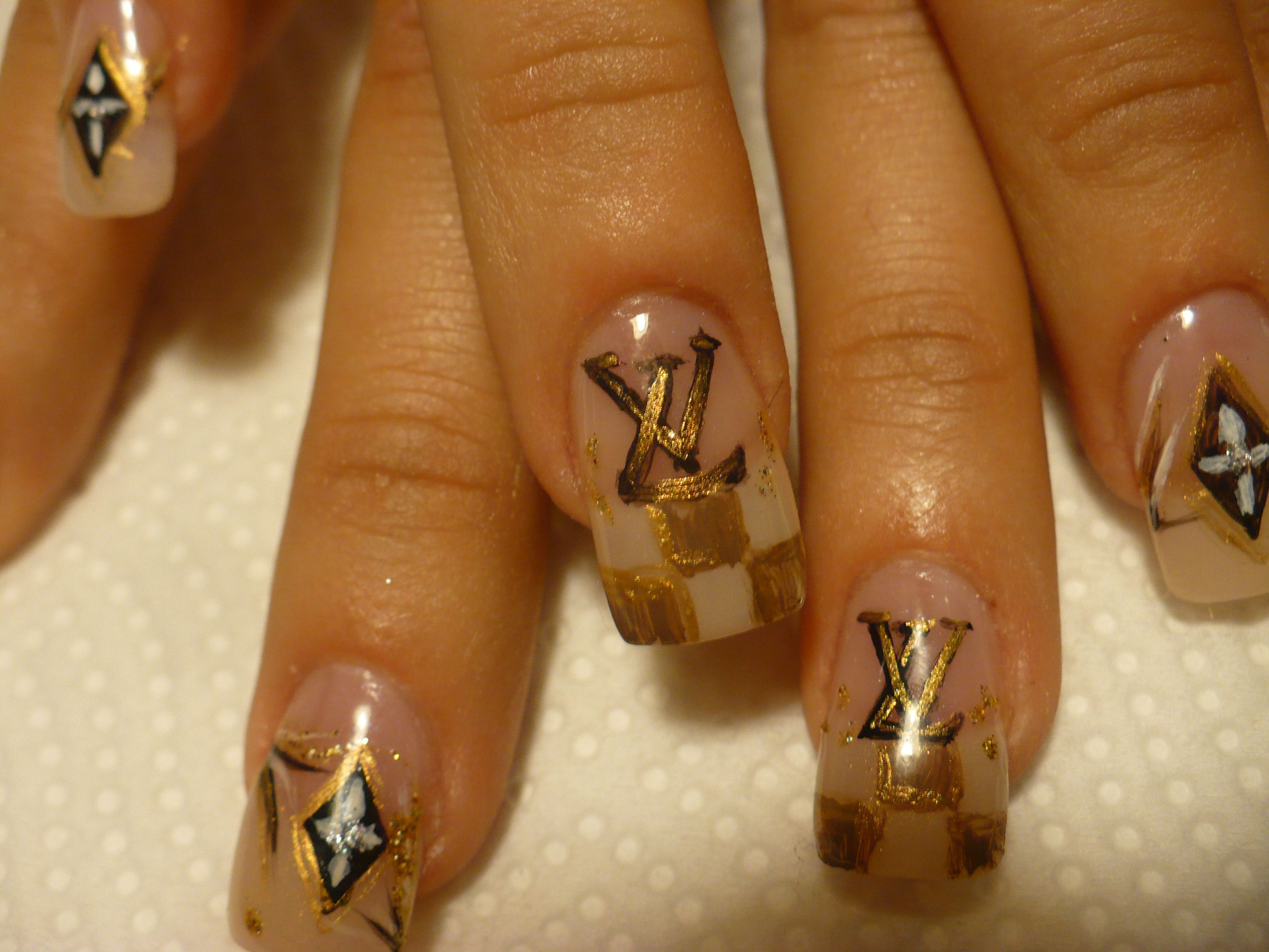 A close up of my nail designs inspired by Louis Vuitton and my model ...