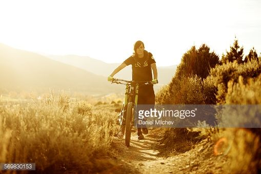 Girl Pushing Her Mountain Bike At Sunset With Images Sunset