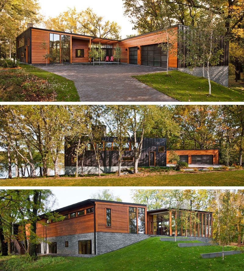 This Modern House Covered In Wood Metal And Stone Has Floor To Ceiling Windows That Follow The Line Modern Wood House House In The Woods Modern Wooden House