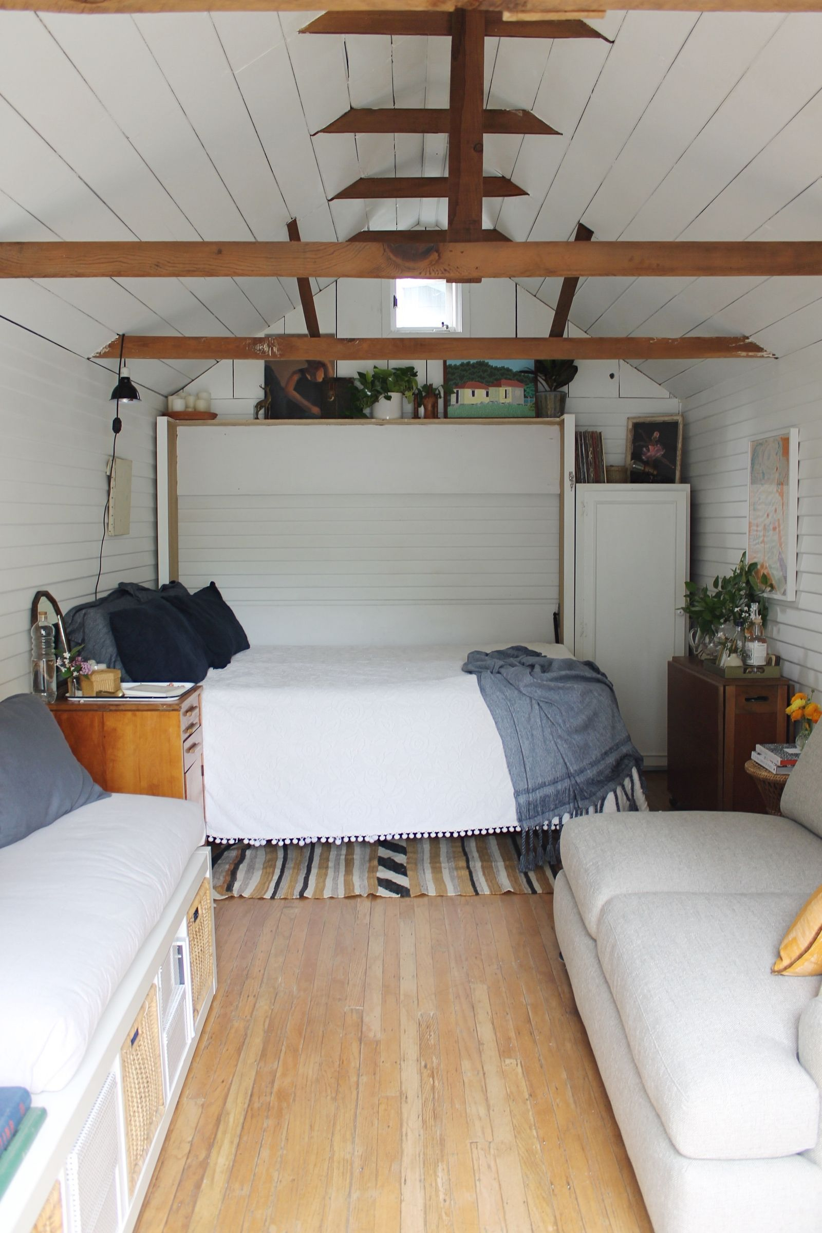 Loft bedroom in garage  This Couple Turned Their Grandmaus Garage Into the Cutest Tiny House