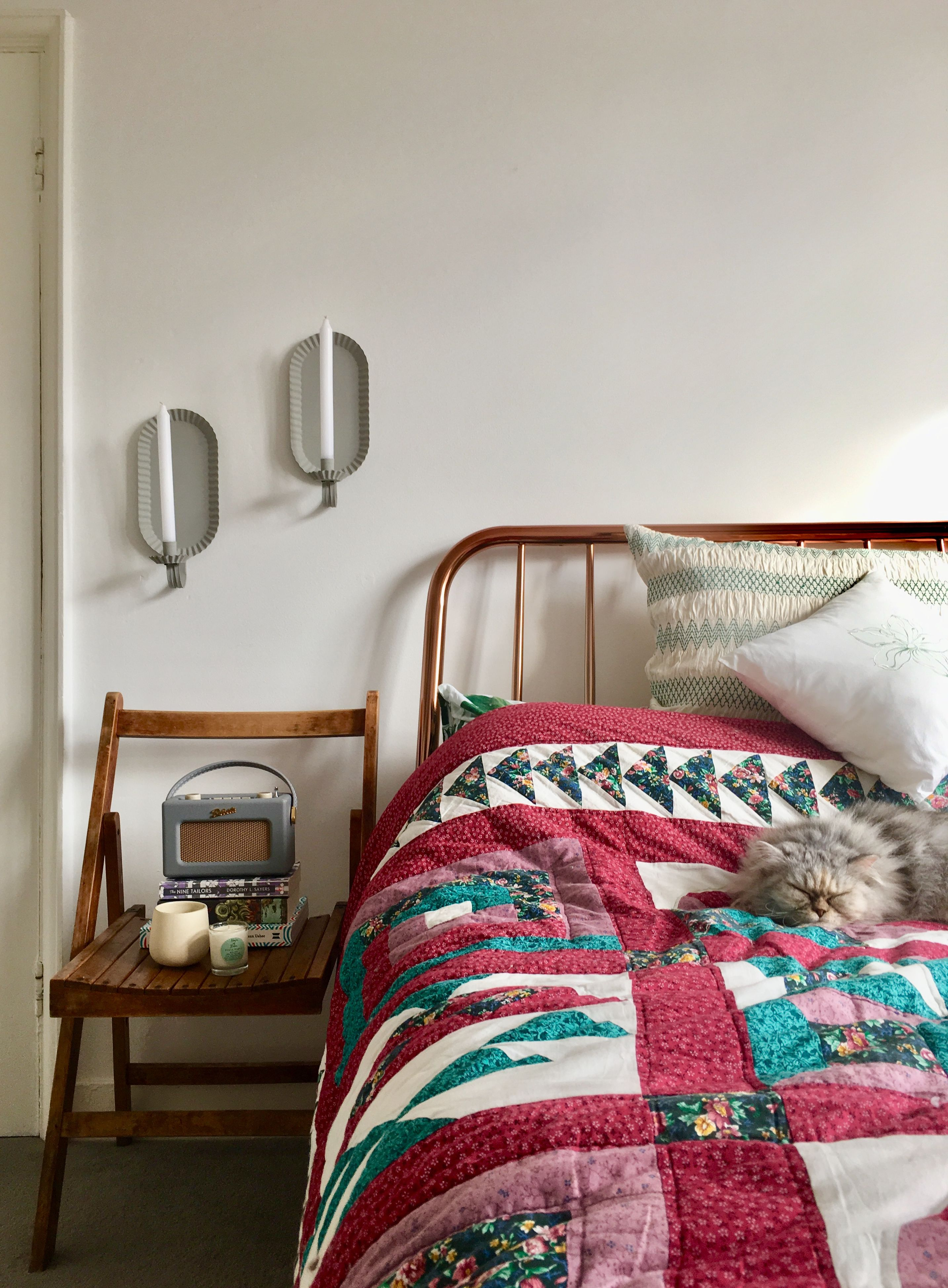 Copper Bed Frame Patchwork Quilt And Vintage Candle Holders My