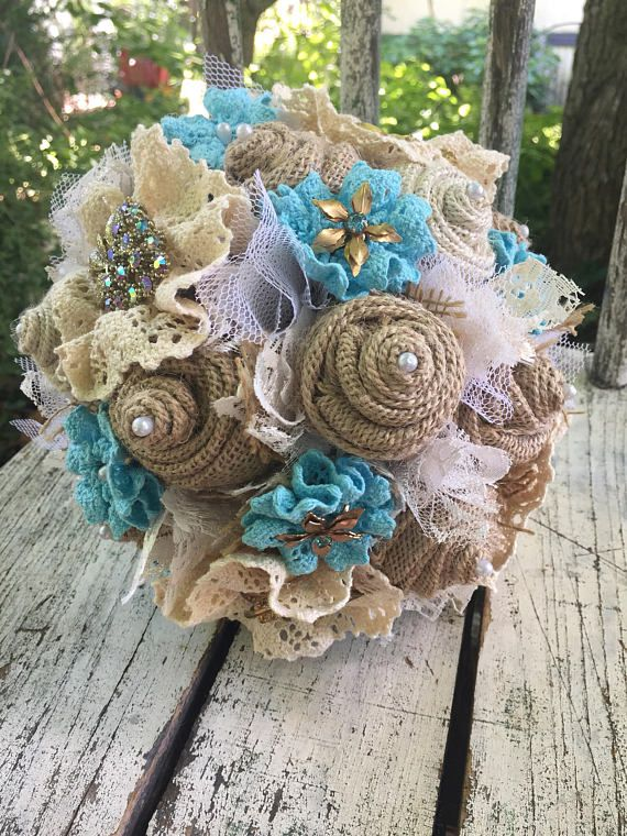 A Rustic Glam Brooch Bridal Bouquet With Tan And Oyster Cream
