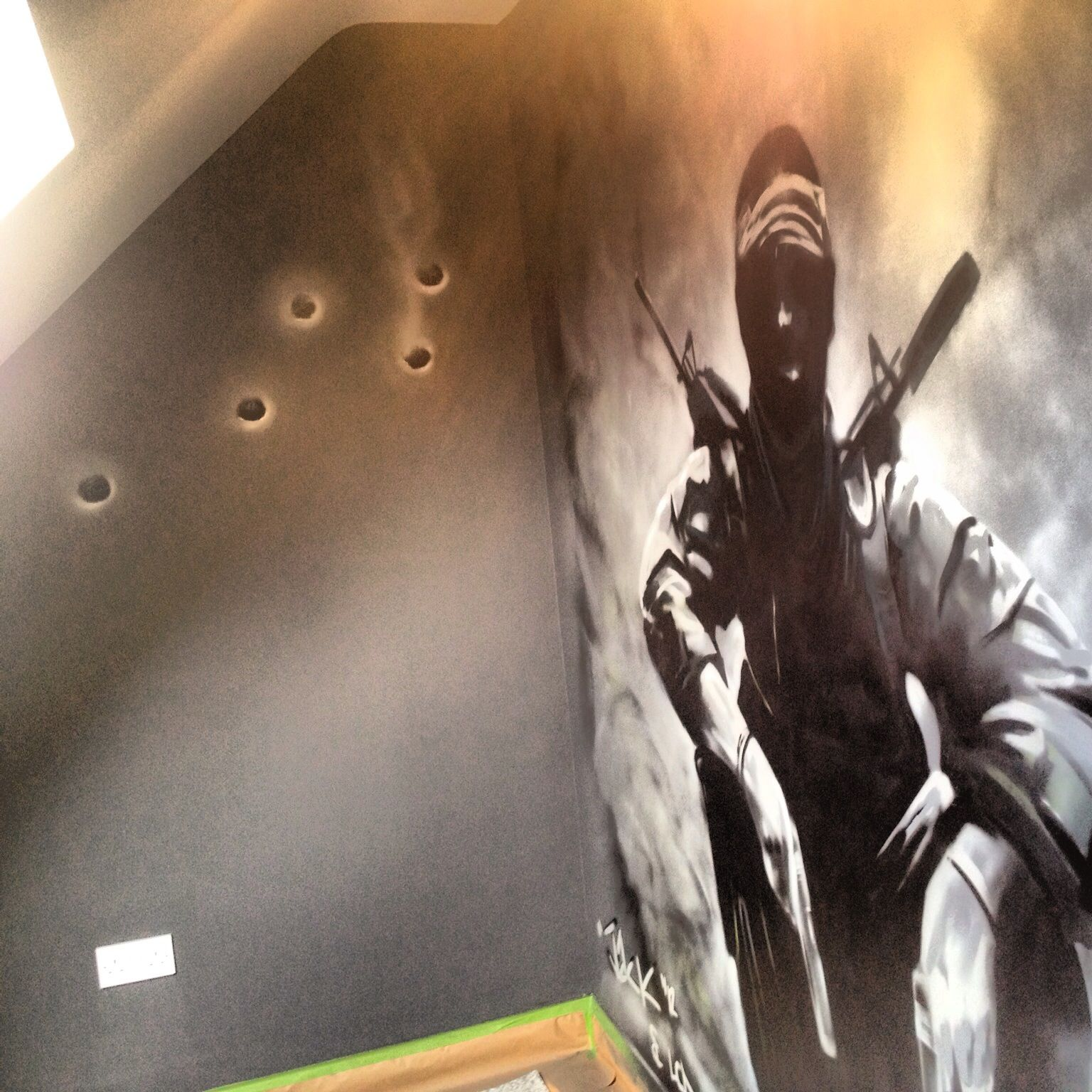 In a kids little snug/games room Call of Duty theme. Bullet holes aren't really real they where sprayed on by me.