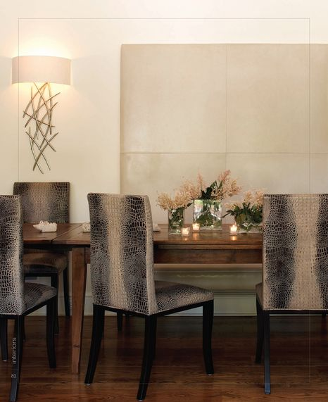 Modern sconce in dining room by designer Lynne Scalo. Photo by Phillip Ennis. From Interiors Digital.
