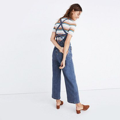 64b347d2702 Cue the compliments—this wide-leg denim jumpsuit has instant-party  crisscross straps that tie in back. Bare a little skin or try it  overalls-style with a ...