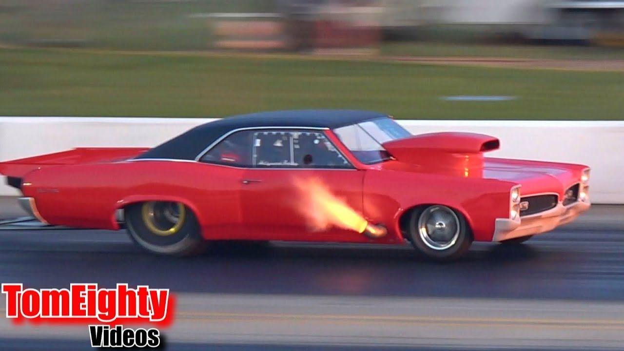 Hollywood Bobby's GTO shooting flames and pulling wheelies at Street