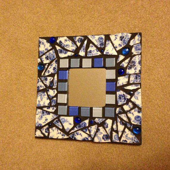 Mosaic mirror in blue and white broken china and by TamarDesigns