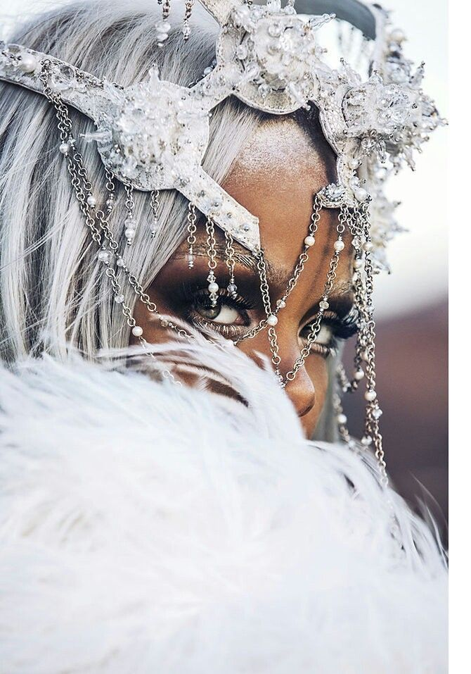 Rihanna dons silver wig as she wears thigh high boots and leotard ...