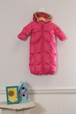 Super heavy-duty snow suit with legs that can be zipped apart to fit in a car seat. Sleeve can be folded over to cover hands.