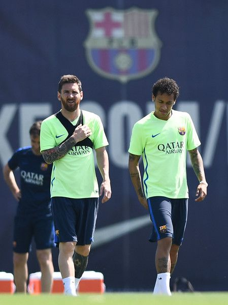 Lionel Messi (L) and Neymar Jr. of FC Barcelona chat during a training session at FC Barcelona Sports Centre on May 26, 2017 in Barcelona, Catalonia.