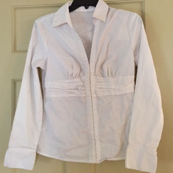 "The Different Basic White Shirt Everyone needs a basic White shirt. This one hooks in front. No Label! Looks like a Size Medium. 38"" bust. 23"" Sleeve. Gently Worn. Tops"