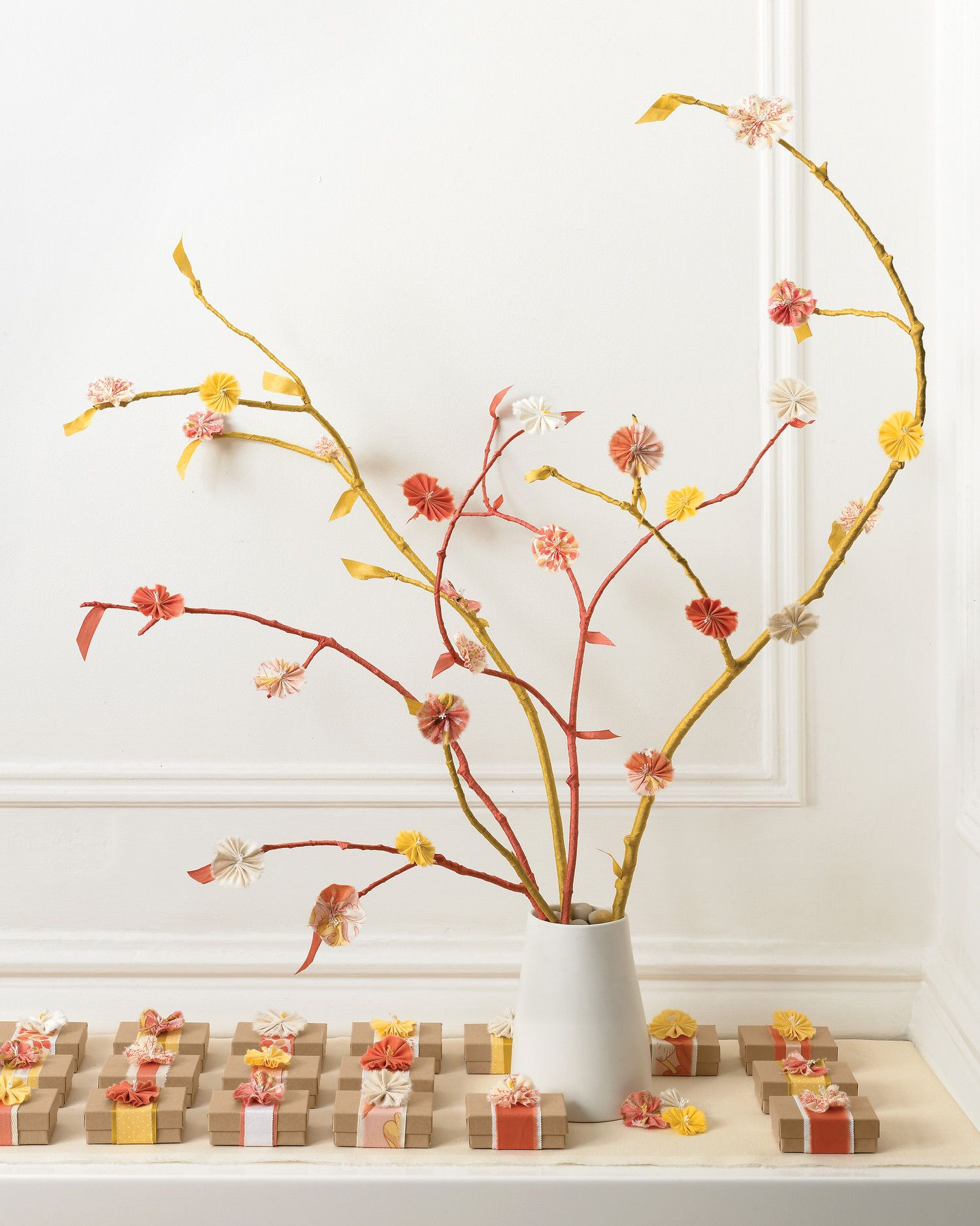 An arrangement of branches wrapped in seam binding and bedecked with ...