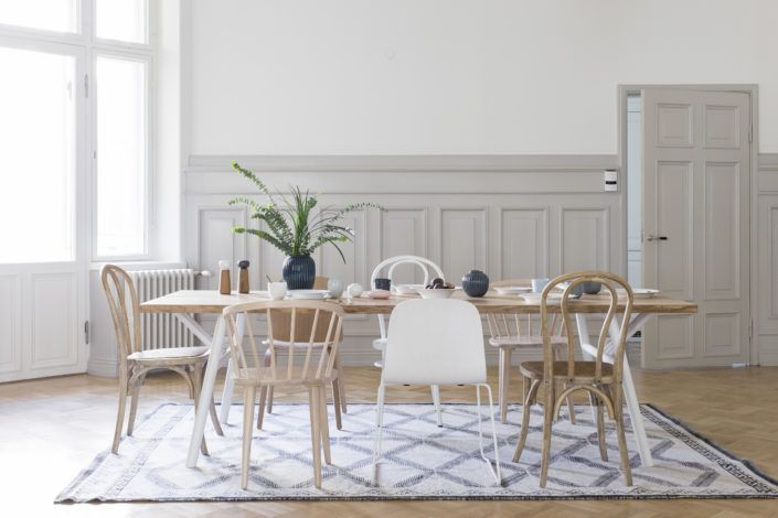 The mix of chairs at this table really liven up the room. This is the Woody table by designer Annaleena Hämäläinen, made by carpenter Petri Karjalainen in Jurva, Finland.