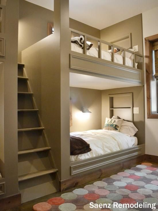 A Very Fun Kids Room With Custom Built Bunk Bed In Shelves White Bedding And Real Staircase Leading To The Top