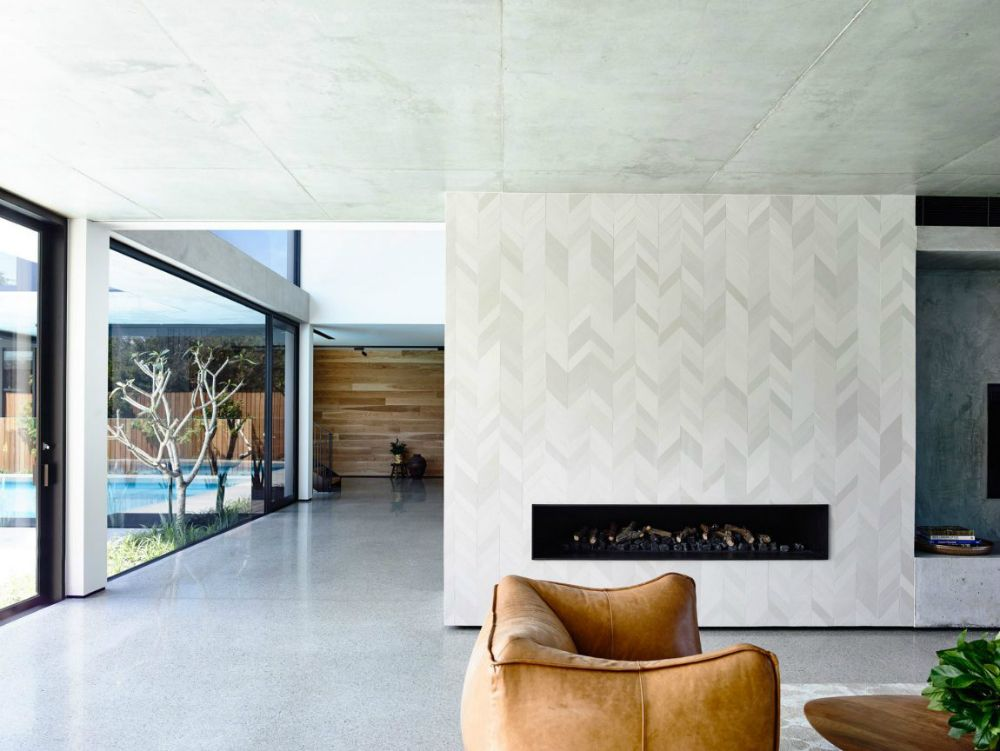 Fireplace Feature Wall Is Laid Out With Marble Tiles Trendir Oak Cladding Fireplace Wall Interior Design Inspiration