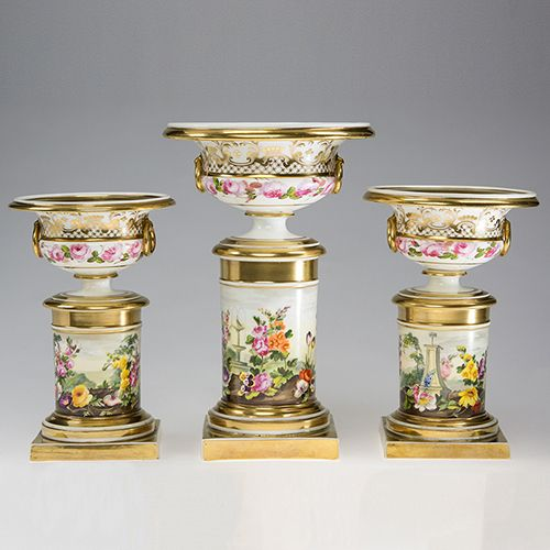 Magnificent Swansea garniture of three urns on pedestals, apparently of unrecorded form, well painted by William Pollard to the bases with continuous garden scenes, . Unmarked, circa 1820