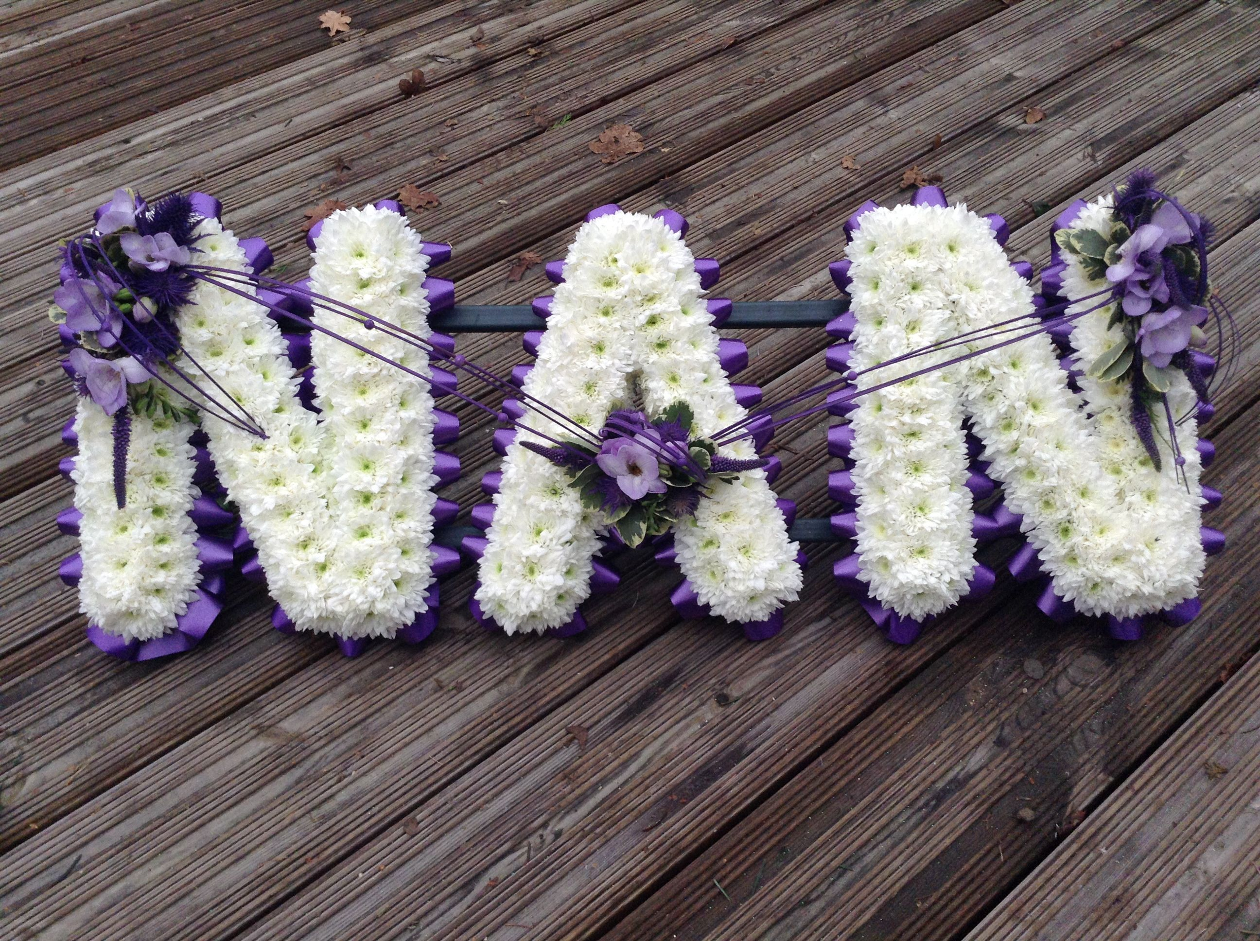 Funeral flowers nan funeral flower letter tribute purple and lilac funeral flowers nan funeral flower letter tribute purple and lilac thefloralartstudio izmirmasajfo Images