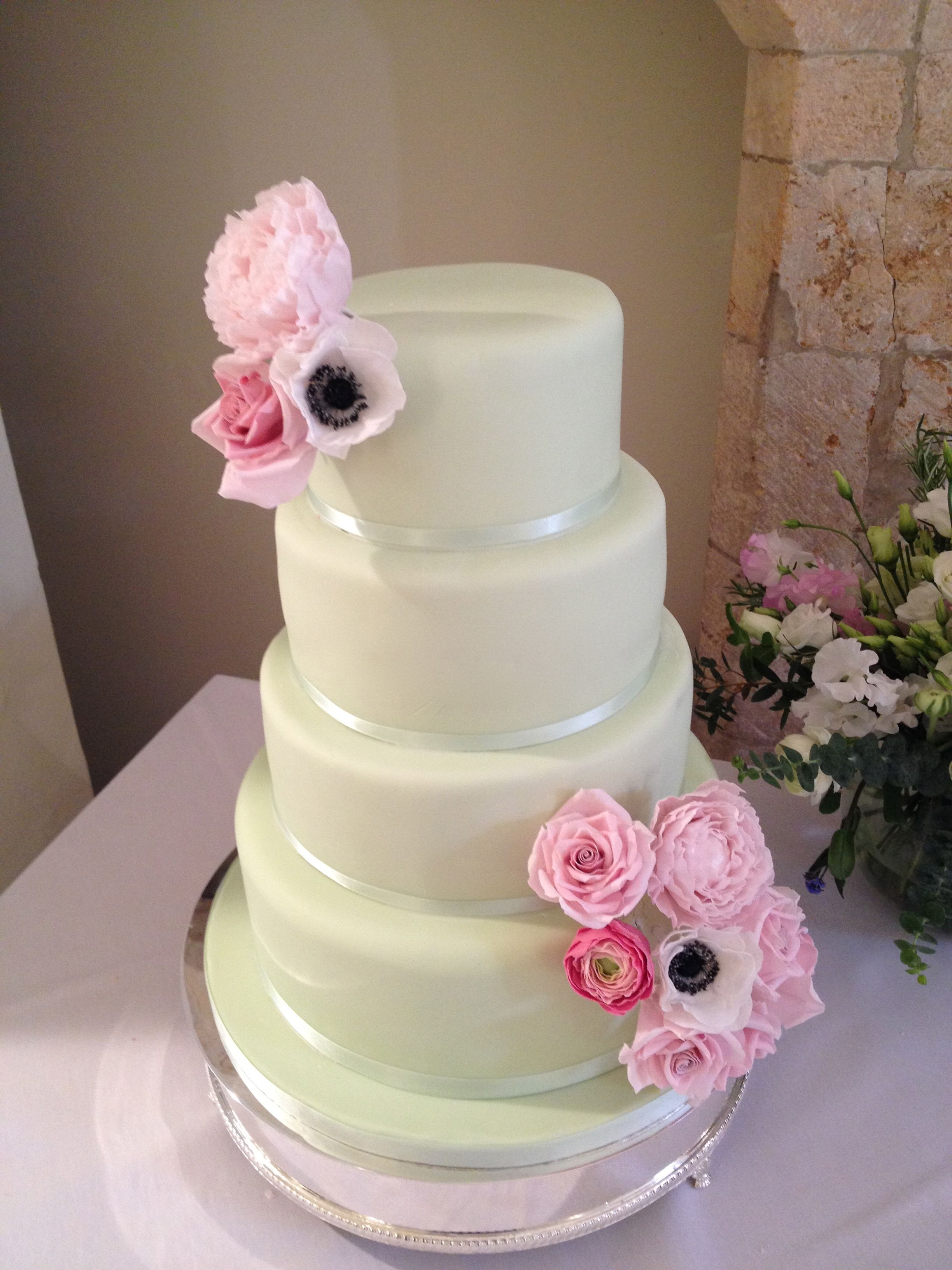Mint green wedding cake with pink sugar roses, peonies, ranunculus ...