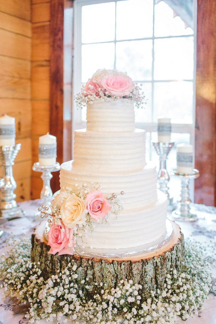 Four tier white wedding cake for a classic winter wedding in January | fabmood.com #winterwedding #weddingcake