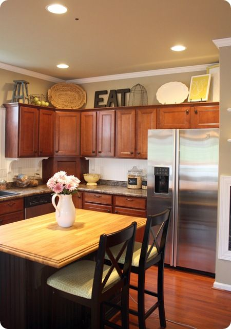 Pretty kitchen- like the decor over the cabinets- I could ...