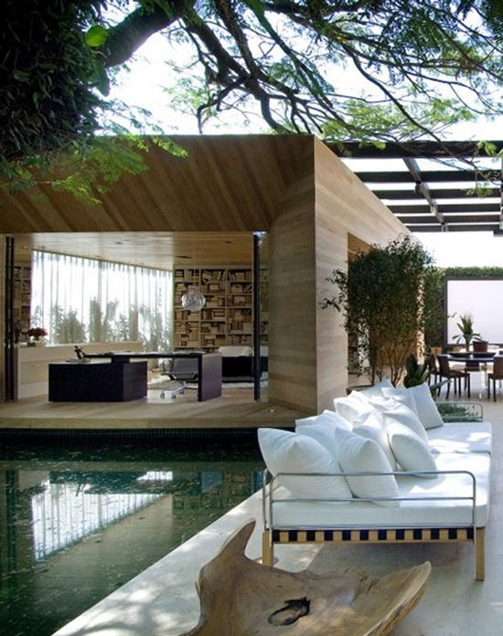 For a country home outside of São Paulo, architect Fernanda Marques evoked the modernist idioms of Mies van der Rohe while emphasizing indoor-outdoor living.