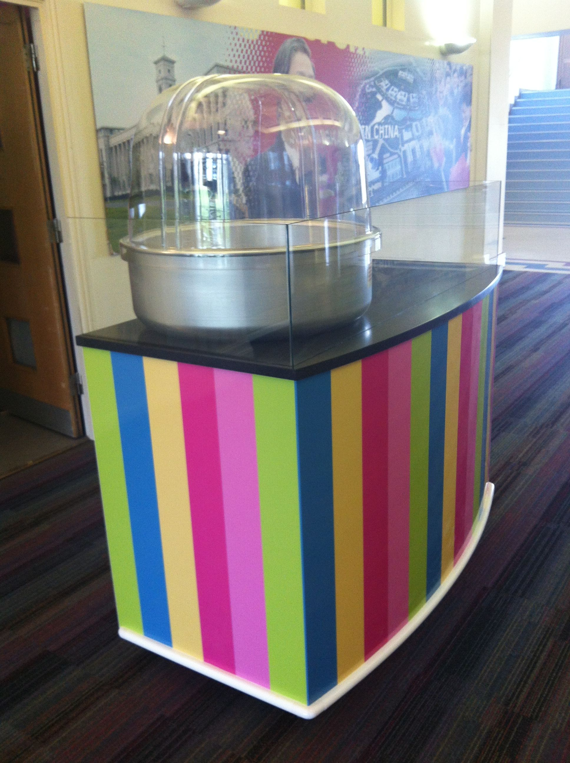 Mobile candy floss stall made from white laminate, Corian top with glass surround. It has been ...
