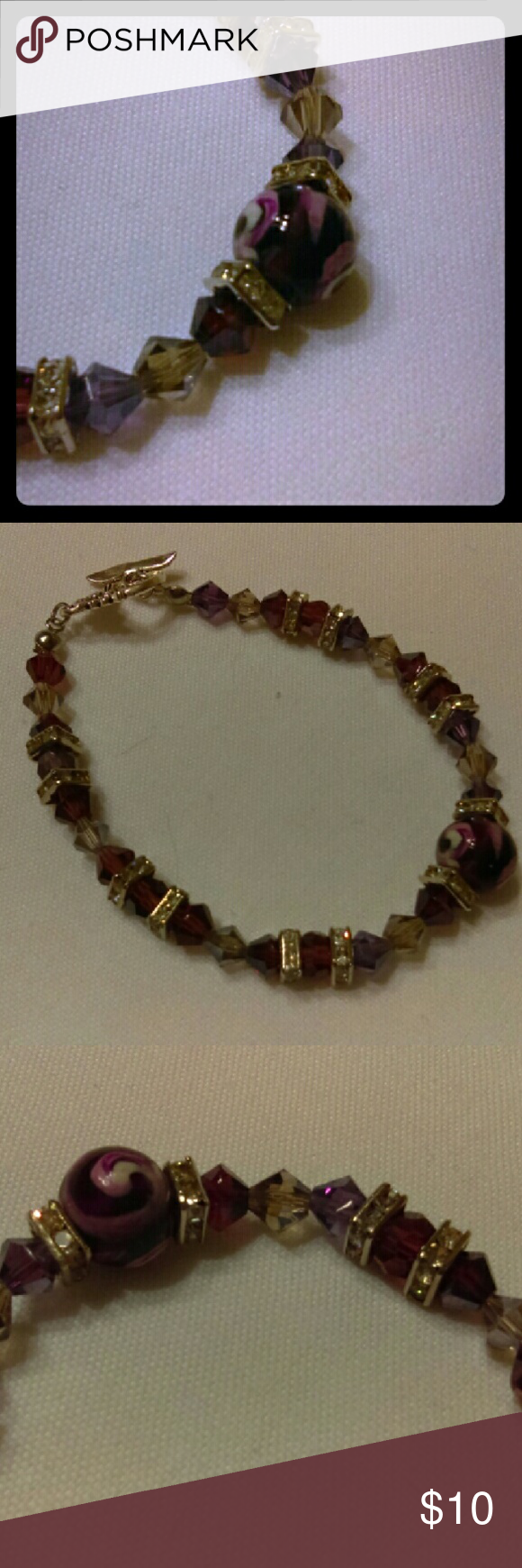 """Handmade Beaded Bracelet Purple Handmade beaded bracelet made with decorated purple glass beads, purple & smoke bicone crystals and silver & rhinestone accents. This bracelet measures 7.5"""", which is the average bracelet size. An extender can be added if necessary at no charge. Jewelry Bracelets"""