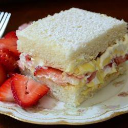 Strawberries and Cream Cake - Sweet and light white cake, layered with strawberries and cream.