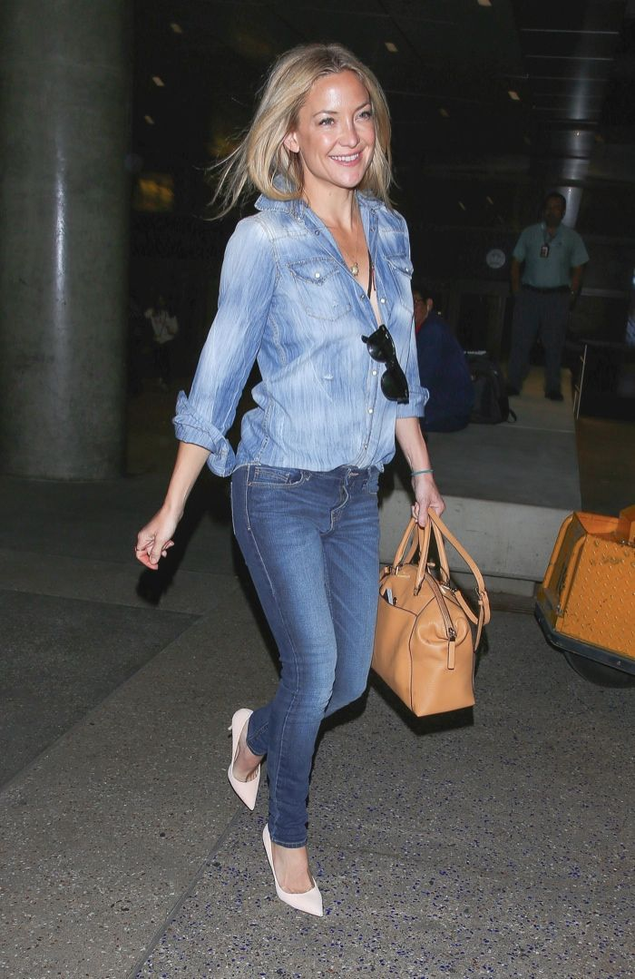 a87b57482a Kate Hudson sports a denim on denim look with her MICHAEL Michael Kors   Riley  Satchel Bag. Photo  Splash News