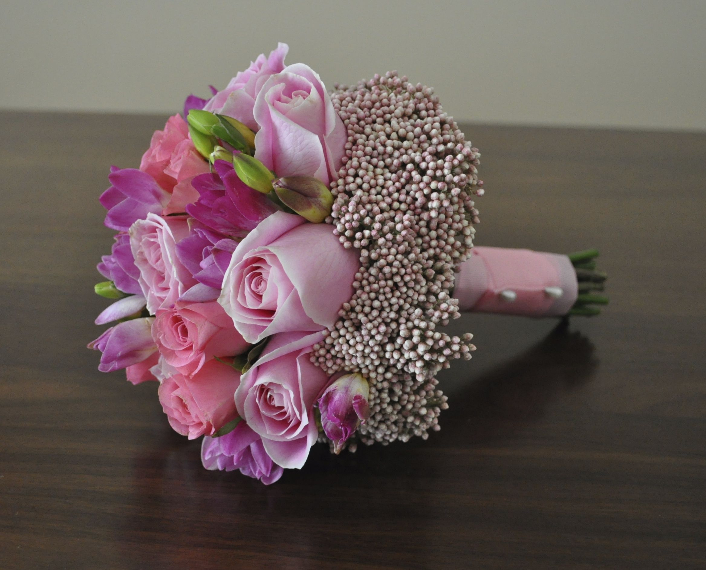 Bouquet of pink roses, pink freesia and pink rice flower for a ...