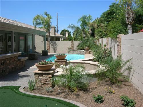 beautiful stacked stone pillars w planters desert. Black Bedroom Furniture Sets. Home Design Ideas