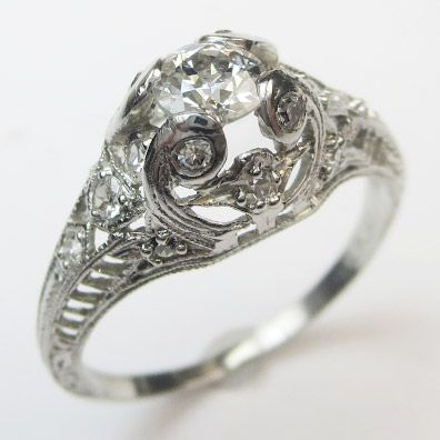 Detailed Diamond Ring: A fantasy of scrolls and petals and graceful lines of filigree, lavishly sculpted and liberally sprinkled with tiny diamonds. Rare and wonderful. Ca.1910 Maloys.com