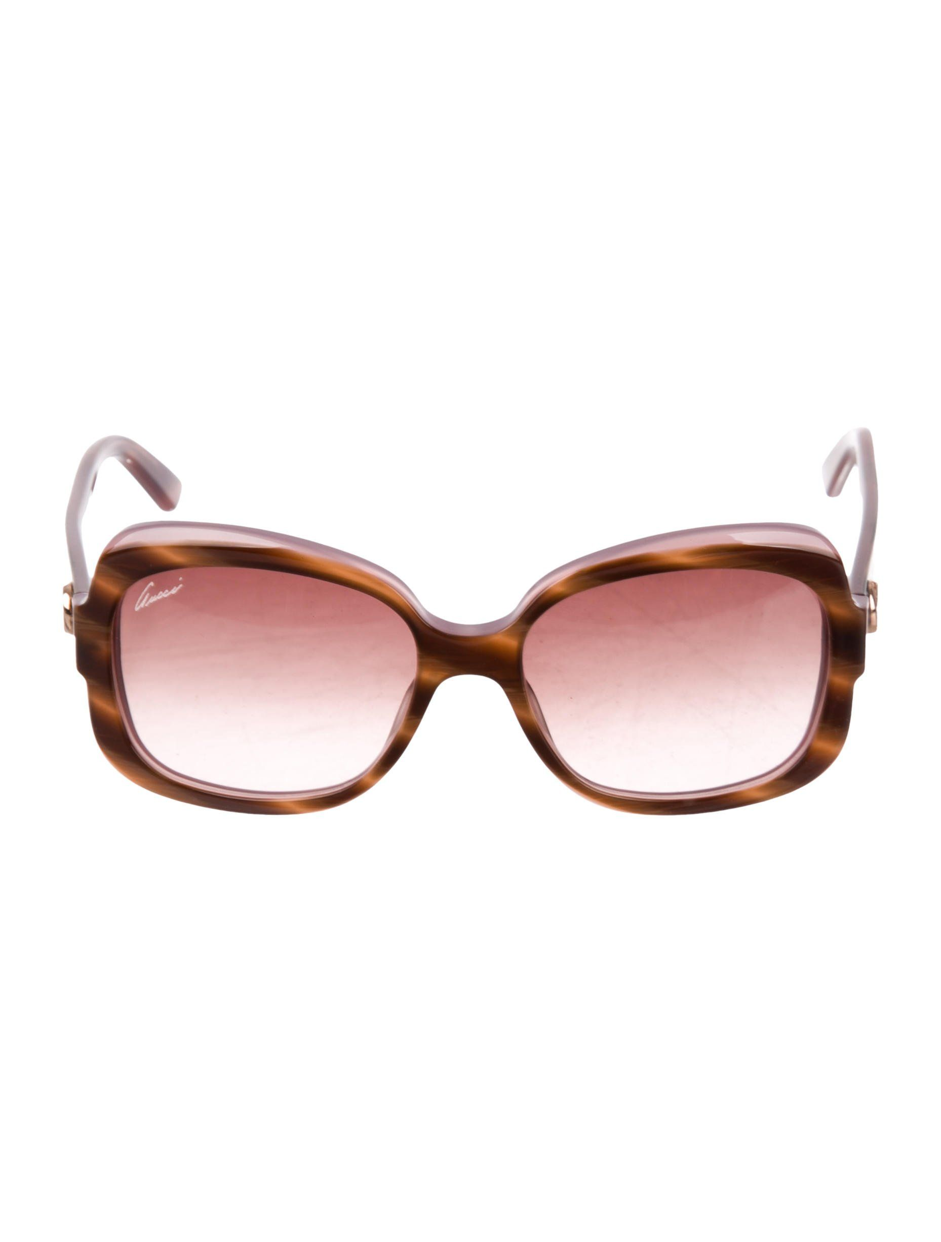 ffb0ae04c92ab Two-tone brown and mauve resin Gucci GG sunglasses with gradient lenses and  gold-tone logo embellishments at temples.