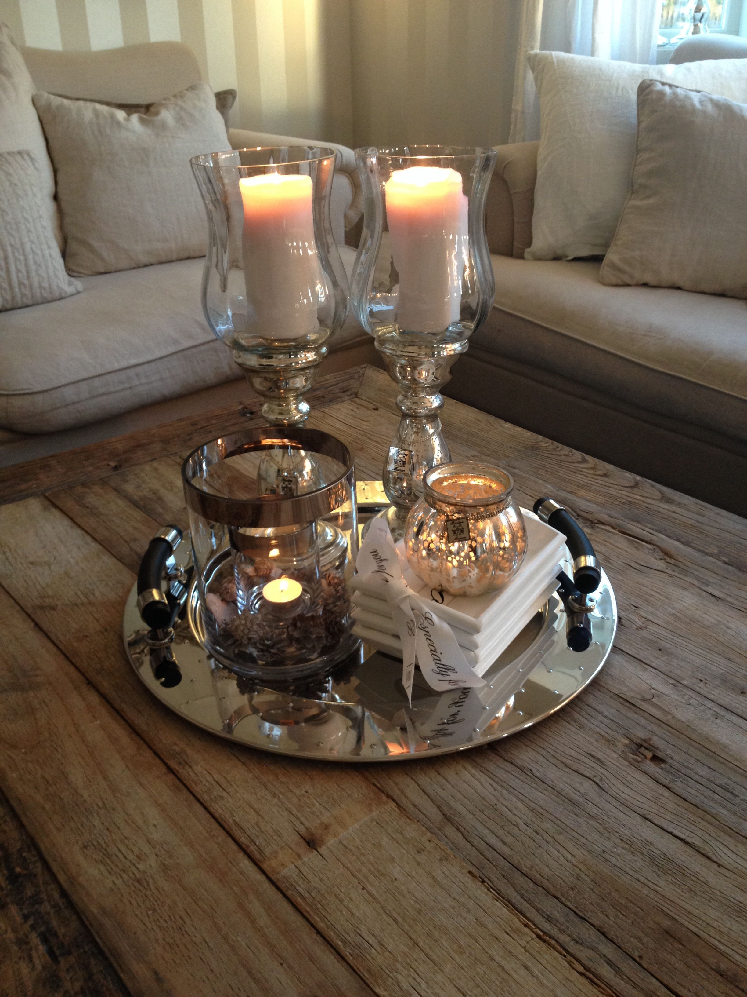 Create multiple tiers to display your decor and candles - Living room center table decoration ideas ...