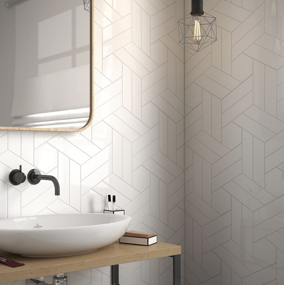 Design Idea Use Simple White Tiles To Create Stylish And Striking Home Interiors Home D Chevron Tiles Bathroom Bathroom Wall Tile Patterned Bathroom Tiles