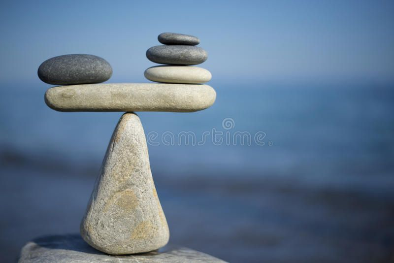 Balance of stones. To weight pros and cons. Balancing