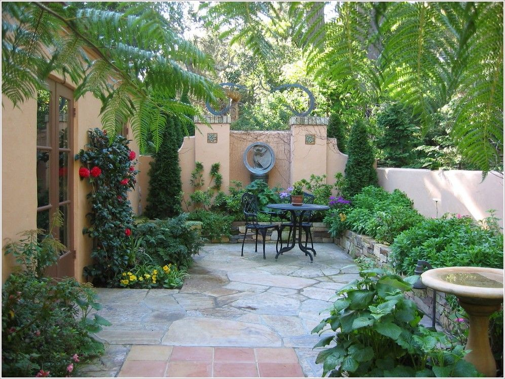 French mediterranean courtyards mediterranean birdbath cafe furniture climbing plants - Mediterranean backyard designs ...