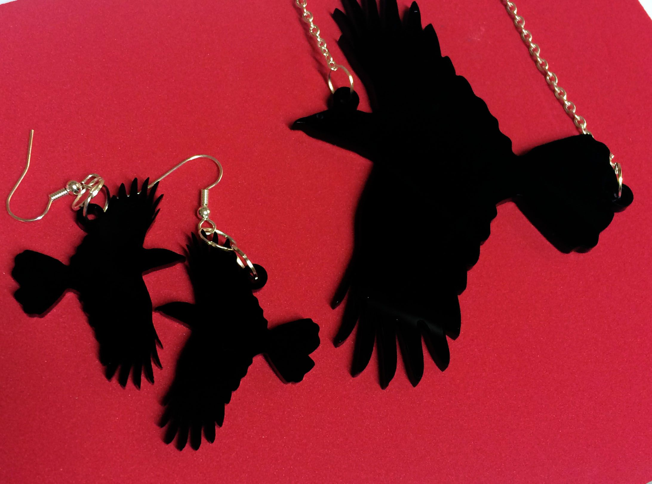 Crow perspex acrylic necklace and earrings set