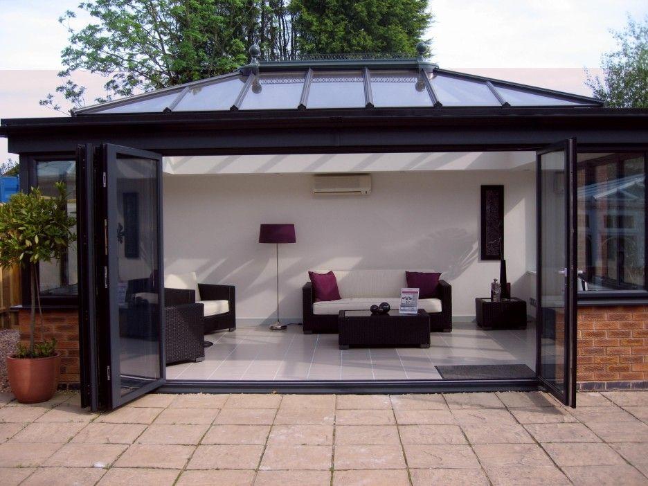 Exterior. Modern White Sun Room Decor With Black Framed Bi Fold Glass Patio  Doors.