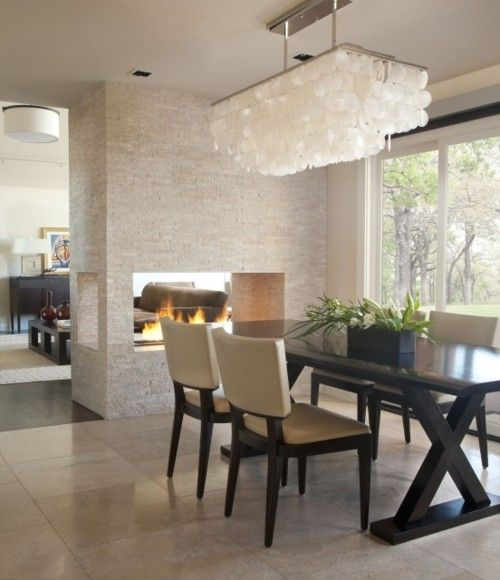 Neutral tones and open fireplace through to lounge. Love the light fixture