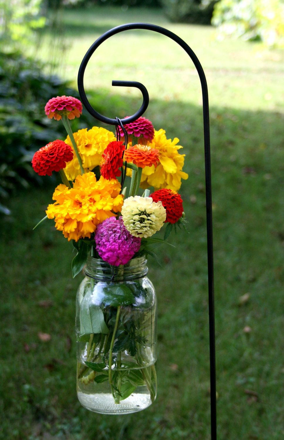 Yard wedding decoration ideas  Shepherdus hooks  mason jars  flowers for along the ceremony