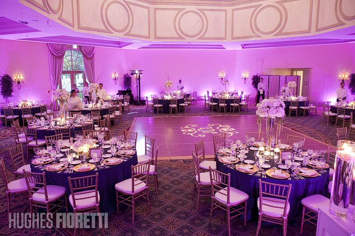 Navy blue and pink wedding reception blue tables purple lights ...
