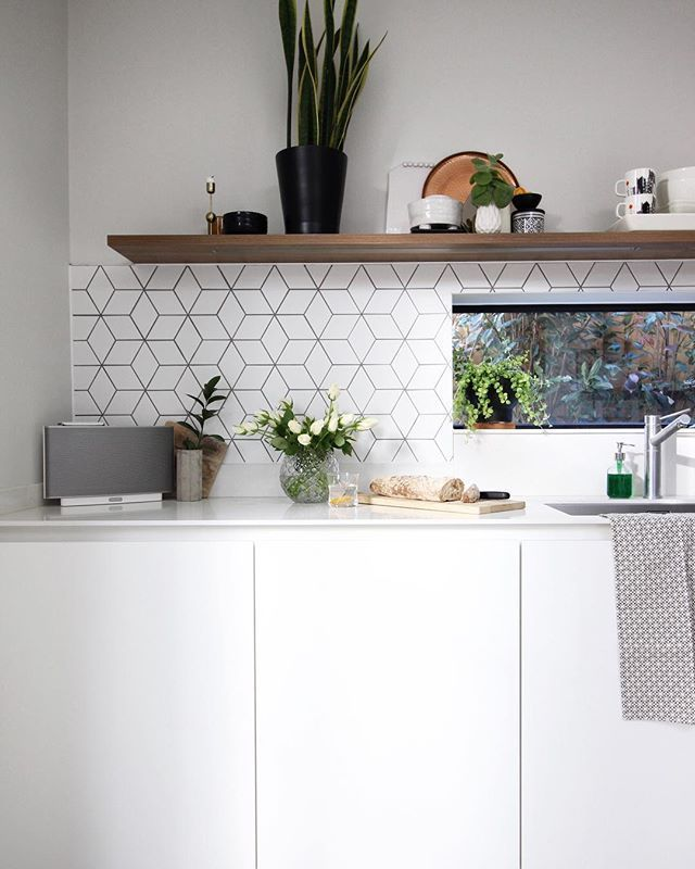 White Kitchen With Open Shelves And Geometric Tiles