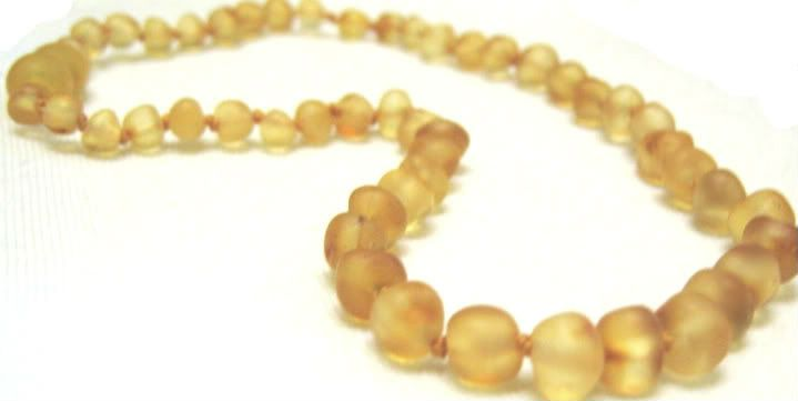 Amber teething necklace... hear it works like a charm to relieve discomforts and drooling